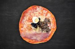 Pizza on black wood Royalty Free Stock Photo