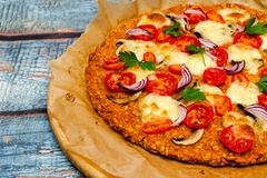 Pizza with blat of sweet potato and oat seeds stock image