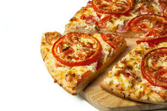Pizza on the board. Close-up Stock Photos