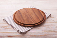 Pizza board with napkin on wooden table. Top view mockup Stock Photography