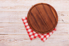 Pizza board with napkin on wooden table. Top view mockup Royalty Free Stock Image