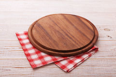 Pizza board with napkin on wooden table. Top view mockup Stock Images