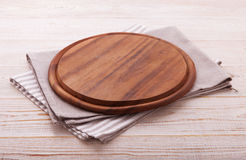 Pizza board with napkin on wooden table. Top view mockup Royalty Free Stock Photography