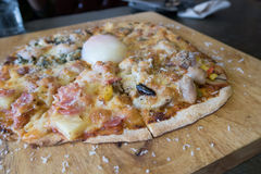 Pizza with boil egg. Home made Pizza with boil egg on top royalty free stock images