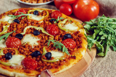 Pizza bolognese on a wooden board. stock image