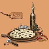 Pizza with bottle of garlic oil Stock Images