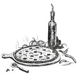 Pizza with bottle of garlic oil. Royalty Free Stock Image