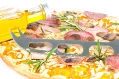Pizza with bottle of olive oil Stock Image