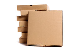 Pizza box, brown, blank, top view, stack of boxes behind, copy space, isolated Stock Images