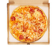 Pizza In Box. Fresh pizza in box, isolated on white Royalty Free Stock Images