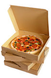 Pizza box open, pepperoni pizza inside, stack of delivery boxes isolated on a white background Royalty Free Stock Photo