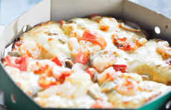 Pizza. A box of seafood pizza Royalty Free Stock Image