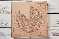 Pizza box on wooden backdrop. Cardboard box for pizza. Packaging for food Stock Image