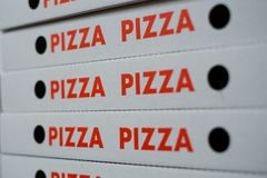 Pizza boxes -   pizza cartons - empty pizza box Stock Image
