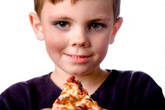 Pizza boy. Boy holding pizza on white background Stock Photo