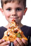 Pizza boy. Boy holding pizza on white background Royalty Free Stock Image