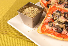 Pizza bread. Freshly baked pizza bread with olives and oregano, a tempting treat stock photo