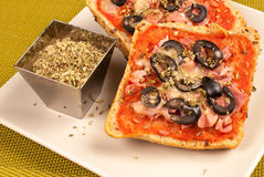 Pizza bread. Freshly baked pizza bread with olives and oregano, a tempting treat royalty free stock photos