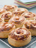 Pizza Bread Scrolls. On a heat rack royalty free stock images