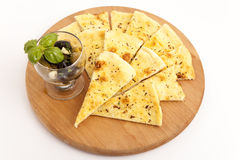 Pizza bread slices. With olives on wooden board royalty free stock photography
