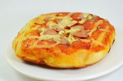 Pizza bread topping pork sausage on dish Royalty Free Stock Photos