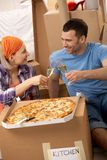 Pizza break at moving house Royalty Free Stock Image