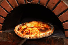 Pizza from a brick oven stock photography