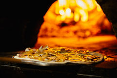 Pizza and brick pizza oven with fire. Pizza and brick pizza oven Royalty Free Stock Photo