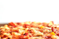 Pizza on the brown plate, isolated Stock Photography