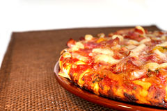 Pizza on the brown plate, isolated Royalty Free Stock Photography