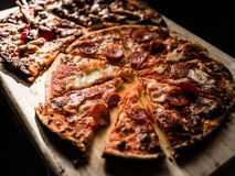 Pizza on Brown Wooden Board Royalty Free Stock Photography