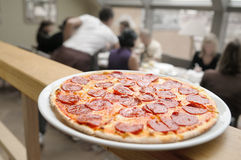 Pizza for a business lunch. Royalty Free Stock Images