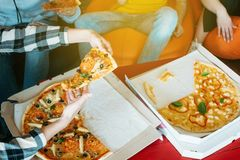 Pizza business team lunch unhealthy delicious meal. Pizza time. Youth eating habit. Business team lunch. Group of colleagues friends relaxing with unhealthy stock image