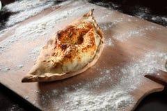 Pizza Calzone Arkivfoto