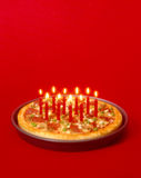 Pizza and candle Royalty Free Stock Images