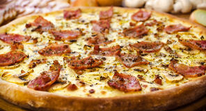 Pizza Carbonara with bacon. And cheese on the table Royalty Free Stock Image