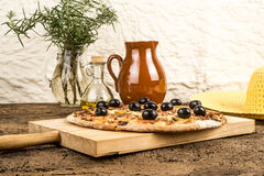 Pizza carbonara on kitchen table Stock Images