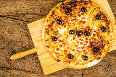 Pizza carbonara on kitchen table Royalty Free Stock Photography