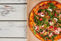 Pizza on cardboard. Royalty Free Stock Image
