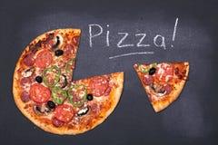 Pizza on chalkboard Royalty Free Stock Photos