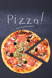 Pizza on chalkboard Royalty Free Stock Photos