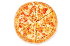 Pizza with cheese, chicken and fresh tomato slices stock images
