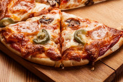 Pizza with cheese and ham Royalty Free Stock Photos