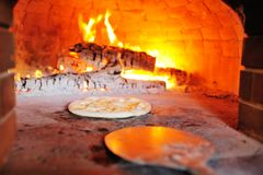 Pizza with cheese in the oven close-up stock photos