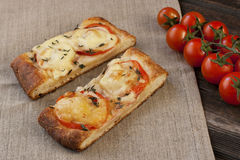 Pizza with cheese, pepper and tomato Stock Photos