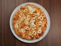 Pizza with cheese in a plate royalty free stock image