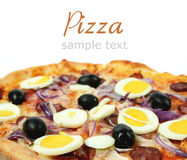 Pizza with cheese, sausage, eggs and olives Royalty Free Stock Image