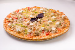 Pizza with cheese, tomatoes and chicken on a white background Stock Photography