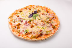 Pizza with cheese, tomatoes and chicken on a white background Stock Photo