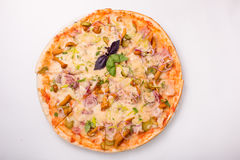 Pizza with cheese, tomatoes and chicken on a white background Royalty Free Stock Photo